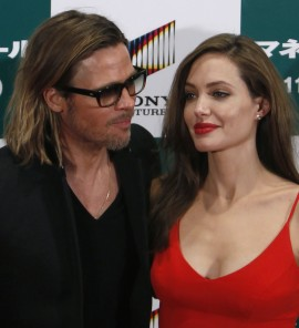 188010-u-s-actor-brad-pitt-and-his-partner-angelina-jolie-pose-during-the-jap