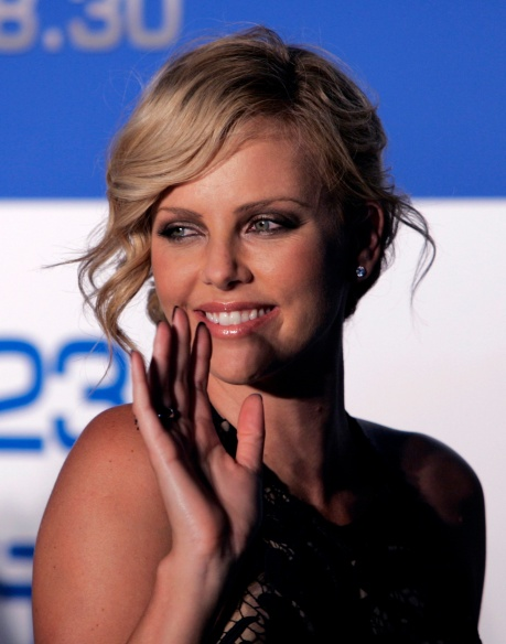 """Actress Theron waves to fans during the Japan premiere of the movie """"Hancock"""" in Tokyo"""