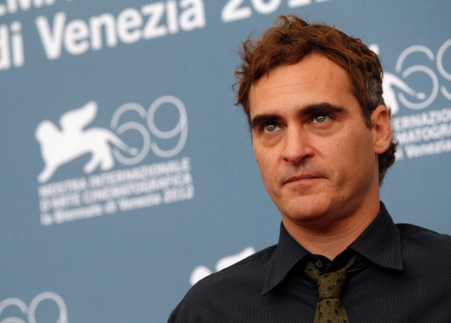 """U.S. actor Phoenix poses during a photocall for the movie """"The Master"""" at the 69th Venice Film Festival"""