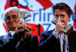 Iranian co-director Partovi waves his Silver Bear award for Best Script next to Director Green who received the Silver Bear for Best Director at the 63rd Berlinale International Film Festival in Berlin