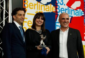 """Director Tanovic with producers Camo and Kolar pose with the Jury Grand Prix Silver Bear award for the movie """"Epizoda u zivotu beraca zeljeza"""" (An Episode in the Life of an Iron Picker) at the 63rd Berlinale International Film Festival in Berlin"""