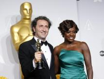 """Paolo Sorrentino, director of Italian film """"The Great Beauty"""" poses with his award for best foreign language film with presenter Viola Davis at thwe 86th Academy Awards in Hollywood"""