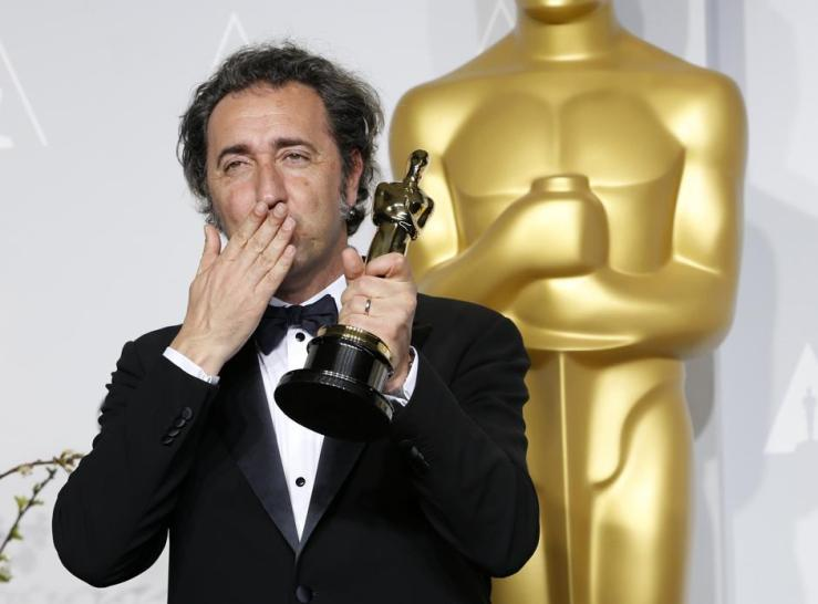 "Paolo Sorrentino, director of Italian film ""The Great Beauty"" poses with his award for best foreign language film at the 86th Academy Awards in Hollywood"