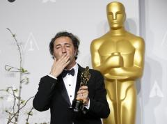 """Paolo Sorrentino, director of Italian film """"The Great Beauty,"""" poses with his award for best foreign language film at the 86th Academy Awards in Hollywood"""