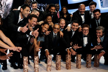 "Director Abderrahmane Sissako poses with team members and the trophies received for the film ""Timbuktu"" at the 40th Cesar Awards ceremony in Paris"