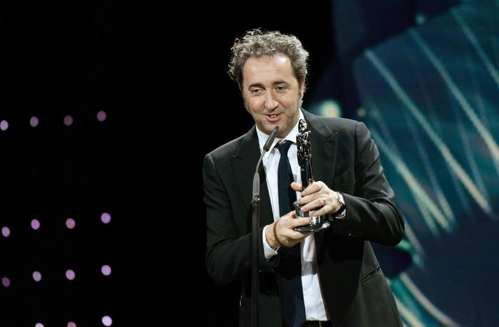 epa05066942 Italian director Paolo Sorrentino receives the award for best European Director during the 28th European Film Award ceremony in Berlin, Germany, 12 December 2015. EPA/CLEMENSBILAN