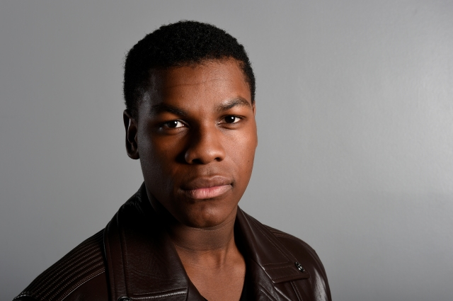 "In this Sunday, Dec. 6, 2015 photo, actor John Boyega poses for a photo during a promotion for the new film, ""Star Wars: The Force Awakens,"" in Los Angeles. Boyega stars as Finn in the J.J. Abrams directed movie that opens in U.S. theaters on Dec. 18, 2015. (Photo by Jordan Strauss/Invision/AP)"