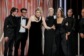 Greta Gerwig director of Lady Bird accepts the award for Best Motion Picture Comedy or Musical at the 75th Golden Globe Awards in Beverly Hills