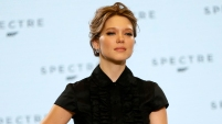 """Image: Actress Seydoux poses on stage during an event to mark the start of production for the new James Bond film """"Spectre"""", at Pinewood Studios"""