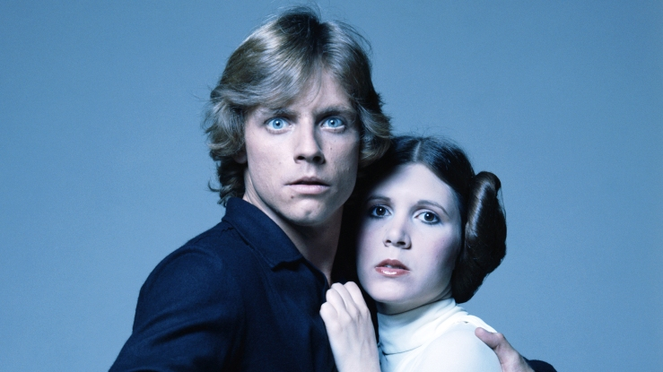 "FILE – OCTOBER 30: It was reported October 30, 2012 that The Walt Disney Company will buy Lucasfilm Ltd. for USD 4.05 billion and begin plans for ""Star Wars: Episode VII."" American actors Mark Hamill and Carrie Fisher in costume as brother and sister Luke Skywalker and Princess Leia in George Lucas' Star Wars trilogy, 1977. (Photo by Terry O'Neill/Getty Images)"