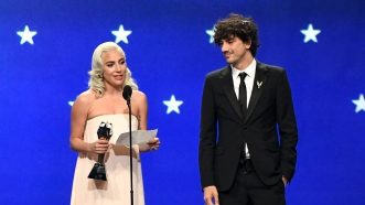 SANTA MONICA, CA - JANUARY 13: Lady Gaga (L) and Anthony Rossomando accept the Best Song award for 'Shallow' from 'A Star Is Born' onstage during the 24th annual Critics' Choice Awards at Barker Hangar on January 13, 2019 in Santa Monica, California. (Photo by Kevin Winter/Getty Images for The Critics' Choice Awards)