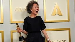 "Yuh-Jung Youn, winner of the award for best actress in a supporting role for ""Minari,"" poses in the press room at the Oscars on Sunday, April 25, 2021, at Union Station in Los Angeles. (AP Photo/Chris Pizzello, Pool)"